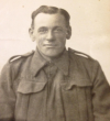 Sepia head and shoulders photograph in uniform